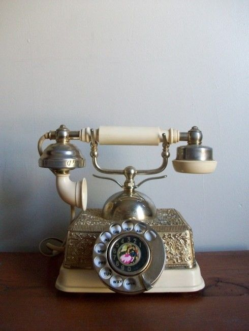 Antique phone. My great gma had one almost exactly like this I grew up using! Always thought it was so neat!