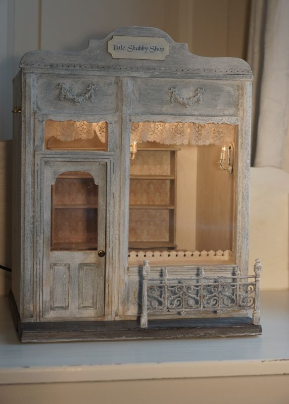 Little Shabby Shop. Simple wood box with a detailed front that opens. Adorable miniature room would be lovely on a bookshelf or stand alone on a table, or as a collection with similarly constructed pieces. --Meggie