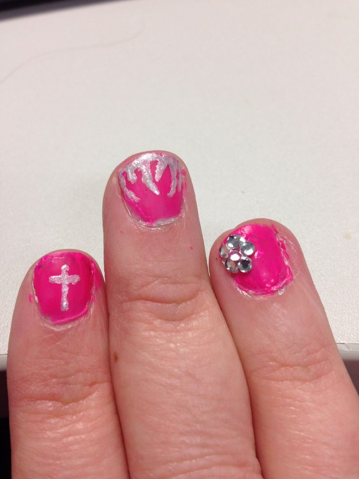 Trio silver cross on pink, silver flame on pink, silver sparkle flower on pink. Nailfy Nail art by Kirsty.