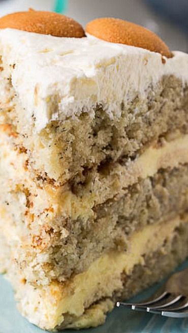 Banana Pudding Cake ~ A layer cake with all the flavor of banana pudding. Between the layers is a creamy banana pudding filling with Nilla wafers and fresh banana slices. The cake is covered in a delectable whipped topping frosting.