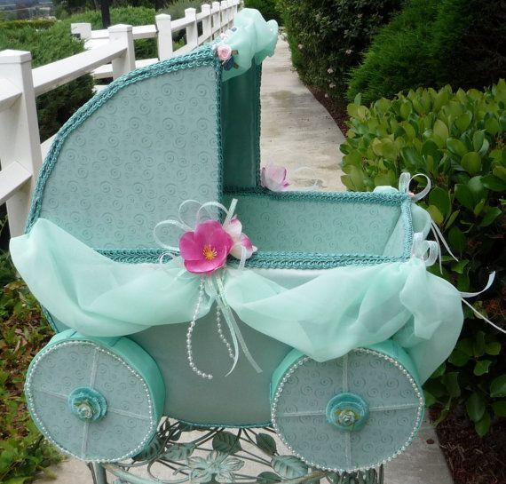 Mint green baby carriage centerpiece carriage by for Baby carriage decoration