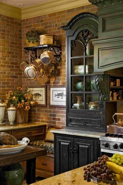 French Country Kitchen by designers Sally Wilson and John Kelsey of Wilson Kelsey Design, brick walls, black painted cabinets, old world, shutters, antique