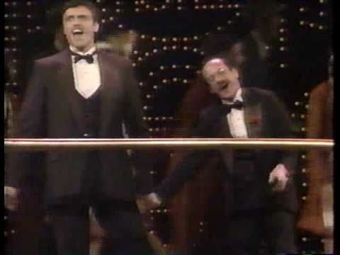 I was looking for a Brent Barrett song, but stumbled across this duet with him and Michael Jeter. Michael Jeter's dancing in this is SO MUCH FUN! He's got rubber legs!  Delightful duet from Grand Hotel.