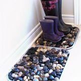There may not be snow falling from the sky right now (at least where I live), but there is still plenty on the ground. And it's a slushy mess. One idea too keep from tracking it into your home is the river rock boot tray from Martha Stewart, which we've highlighted here before. The cool DIY idea caught on, apparently, as it's been done by many around the web: