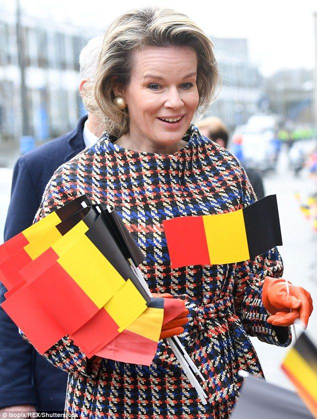Patriotic: Well-wishers handed the queen Belgian flags as she stopped to speak to them...