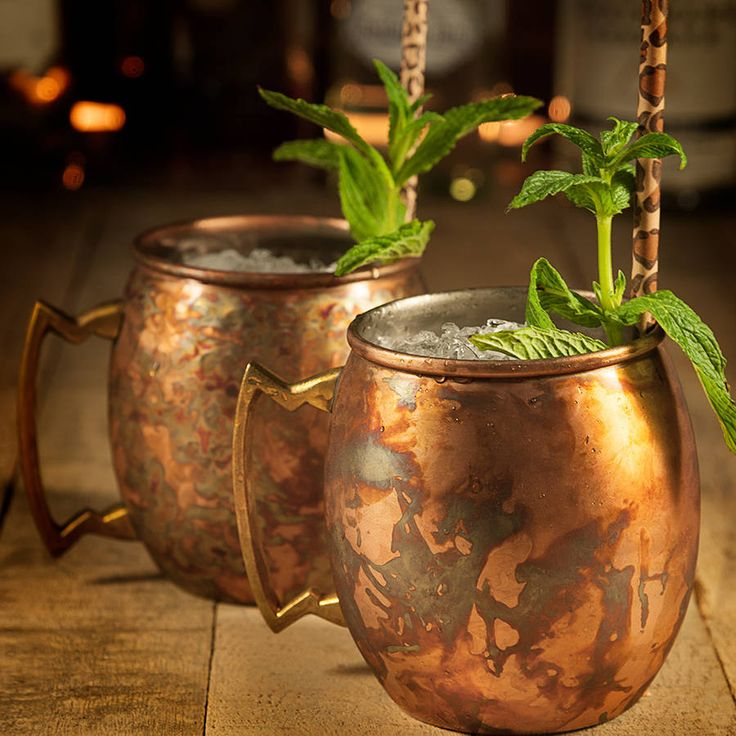 Our classic, rounded, Copper Mule Mugs are perfect for serving your very own Moscow Mule cocktail.Offered in 2 styles - antique smooth and antique hammered. The antique finish means that the natural wear of the exterior copper finish won't be visible like it is on plain copperware, so you'll be enjoying cocktails from our copperware for years to come. Our copper mugs are food safe and you will not experience a tarnished taste when drinking from them.Made from copper and dishwasher safe.H10 x…