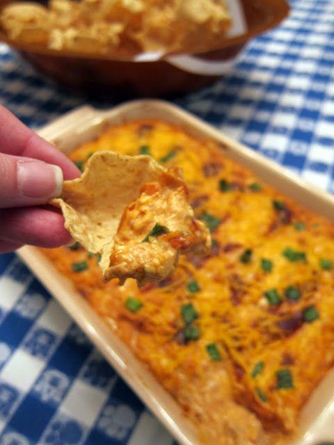 BBQ Chicken Dip...chicken, cream cheese, bbq sauce, ranch dressing, sour cream, cheddar cheese, & green onion.