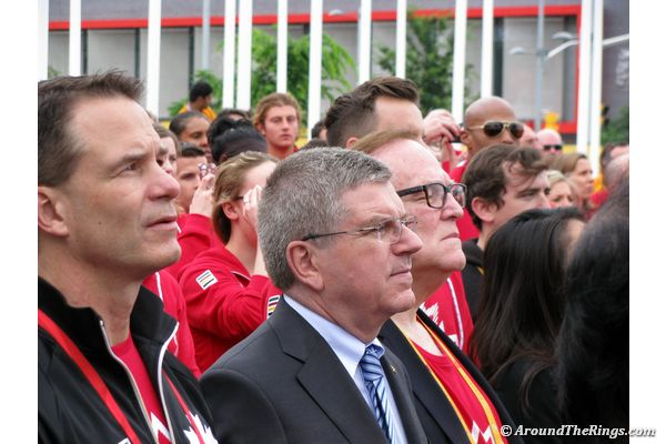 Thomas Bach watches as the Candian flag is raised (ATR)