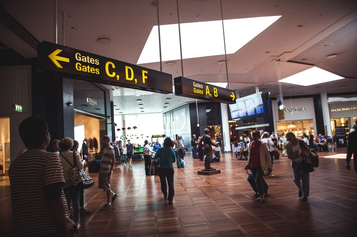 Travelers at Copenhagen Airport.