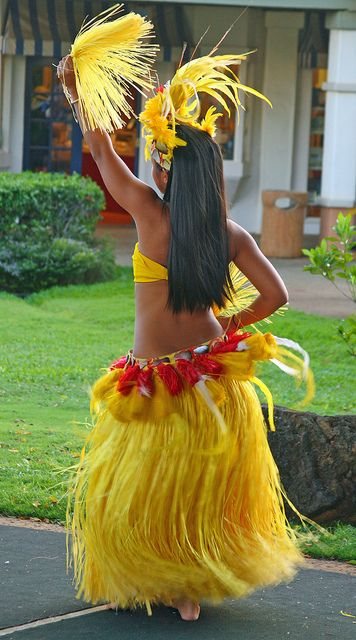 Hula dancer performing in Tahitian outfits by Alaskan Dude, via Flickr