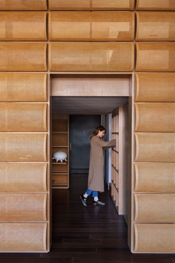 A room with wicker walls forms part of this sanctuary that Argentinian office Estudio Normal has built in the home of a Buenos Aires-based chef