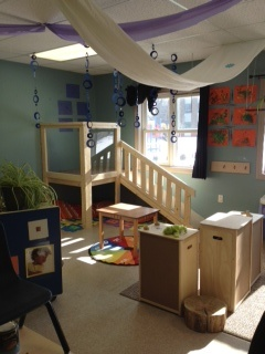 Our beautiful Toddler room.  The indoor climber is a huge hit.  The children look out at the school children out the window and there is a cozy spot underneath.