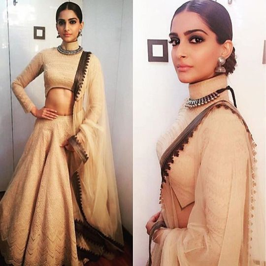 Sonam in Shantanu & Nikhil's classy Lehenga Choli for another appearance in Bigg Boss Double Trouble. Middle parted pulled back hair-bun and dark kohl eyes. She brings out the glory of this beige.