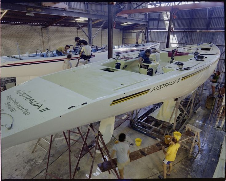322741PD: Working on the hull and winged keel of Australia II in Steve Ward's boatshed, Cottesloe, 31 October 1982 https://encore.slwa.wa.gov.au/iii/encore/record/C__Rb3159341