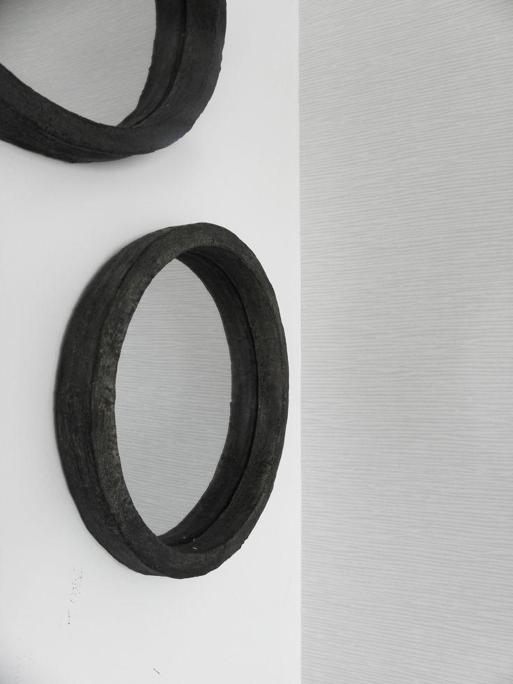 subtle wallpaper reflecting in round mirror