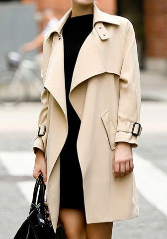 Throw on a draped camel trench over your simple black dress for fall travels / the love assembly