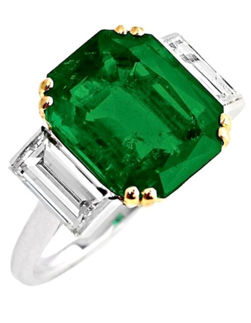 """Cartier 1940s 7.45 Carat Colombian Emerald Three Stone Ring.   An exquisite 7.45 carat colombian emerald ring with two baguette diamonds, set in platinum and 18kt yellow gold, mounted by Cartier. The emerald accompanies a gemological report from AGL stating the country-of-origin as Colombia with no oil. The ring is signed """"Monture Cartier"""", numbered R4224 with French assay marks and maker's mark. Ring Size: 6 US. Original Vintage Cartier Box Included."""