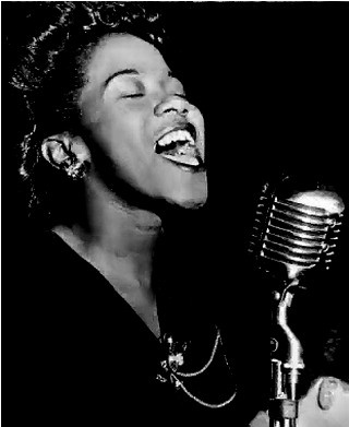 Ella Fitzgerald....Beautiful is not the size your dress is....but the size of your spirit and determination. What an inspiration! <3