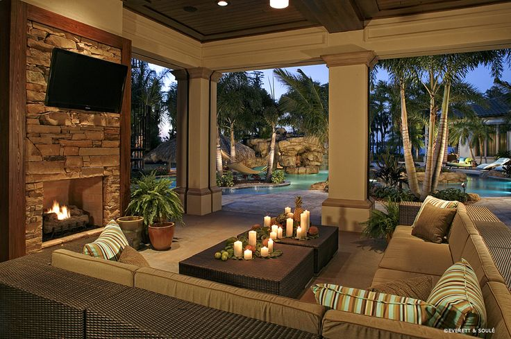 outdoor space with lagoon pool and lake beyond.