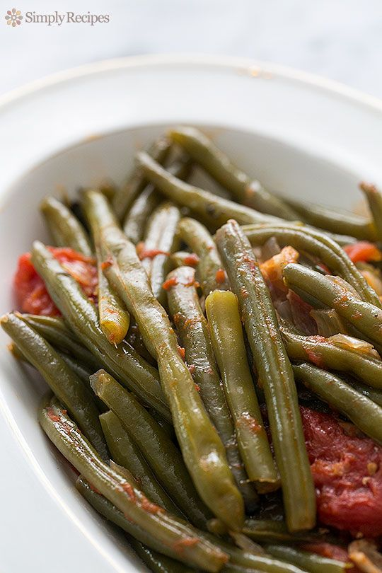 Pioneer Woman's slow cooked fresh green beans with tomatoes, bacon, and onions. A great Thanksgiving side! ~ SimplyRecipes.com