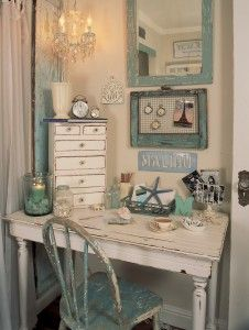 Beautiful shades of turquoise and shabby chic style distressed furniture make this