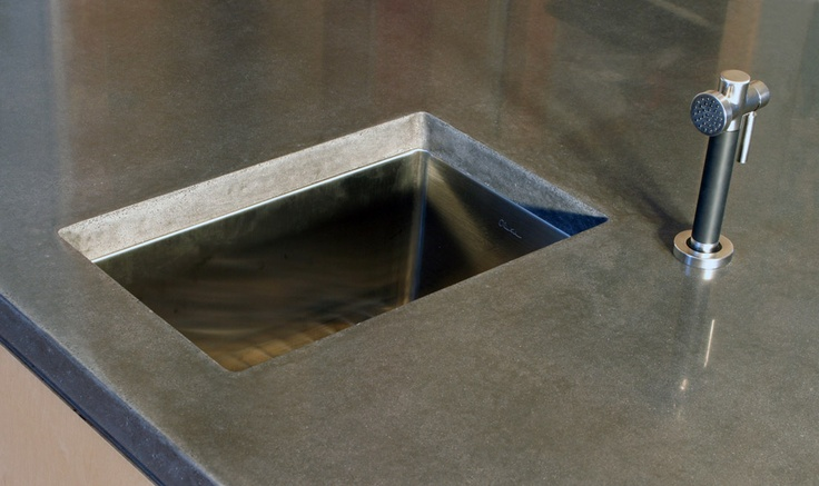 """An under mount sink """"shows off"""" the profile of your concrete benchtop."""