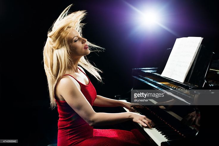 Stock Photo : Beautiful woman playing piano with passion.
