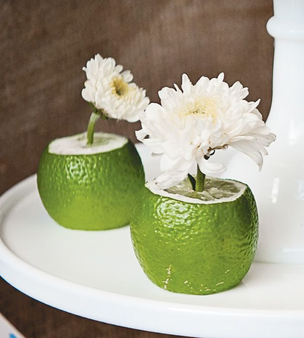 interesting.. Mexican Lime & Floral Table Decor: Another good idea would be to stick toothpick tags in them for placecards or for taco bar food labeling.