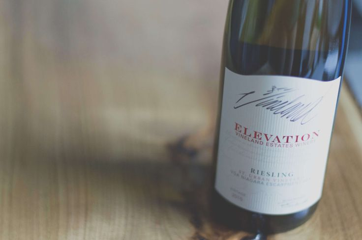 Signed bottle of Elevations Riesling by Vinland Estates on a wooden backdrop   Wineblots