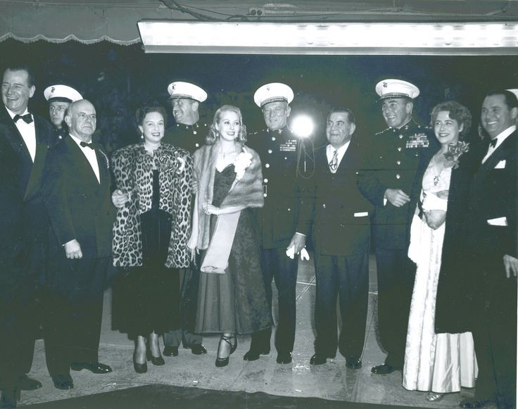 Major General Graves B. Erskine, Sands of Iwo Jima Premiere, 1949  Major General Graves B. Erskine (5th from the right) attends the Sands of Iwo Jima premiere. John Wayne can also be seen in the photograph (1st from the left).   From the Graves B. Erskine Collection (COLL/3065) at the Marine Corps Archives and Special Collections   OFFICIAL USMC PHOTOGRAPH