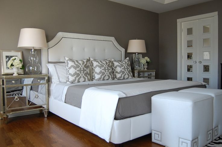 white bed, mirrored side tables