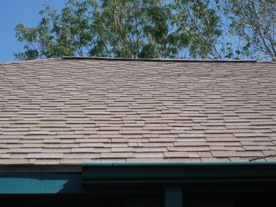Composition Shingle Roofs VS Metal Roofs: Shingle Roof with Ridge Vents