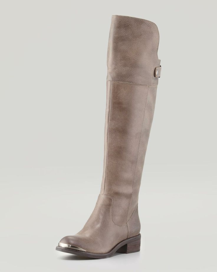 Tall grey boots.
