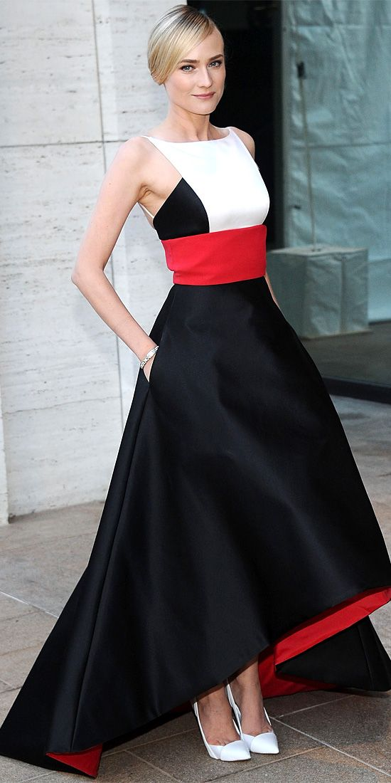 09/24/13: At the Metropolitan Opera House, Diane Kruger was breathtaking in a red-white-and-black satin Prabal Gurung creation with a full #skirt and a high-low hem. A bracelet, onyx earrings and white Casadei pumps served as accessories. #lookoftheday
