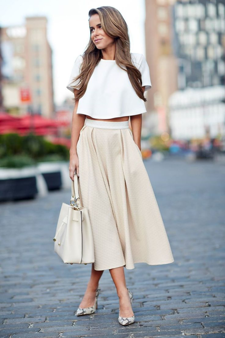 Crop in! Pair a short-sleeved crop top with a flowy skirt for a little added flair.  cc: The Style Bungalow