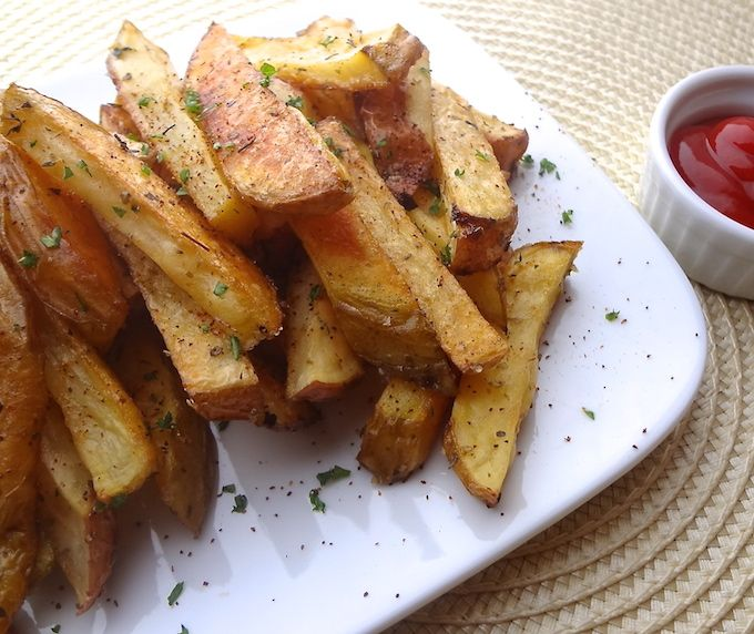 Crispy Baked Seasoned Fries/ The secret to this recipe, combined with a cast iron skillet, takes oven baked fries to a new level. You won't find better baked seasoned fries!