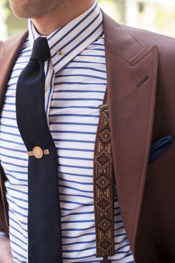 Shop this look on Lookastic:  http://lookastic.com/men/looks/dress-shirt-tie-pocket-square-suspenders-blazer/8754  — White and Blue Horizontal Striped Dress Shirt  — Navy Tie  — Navy Pocket Square  — Brown Print Suspenders  — Burgundy Blazer