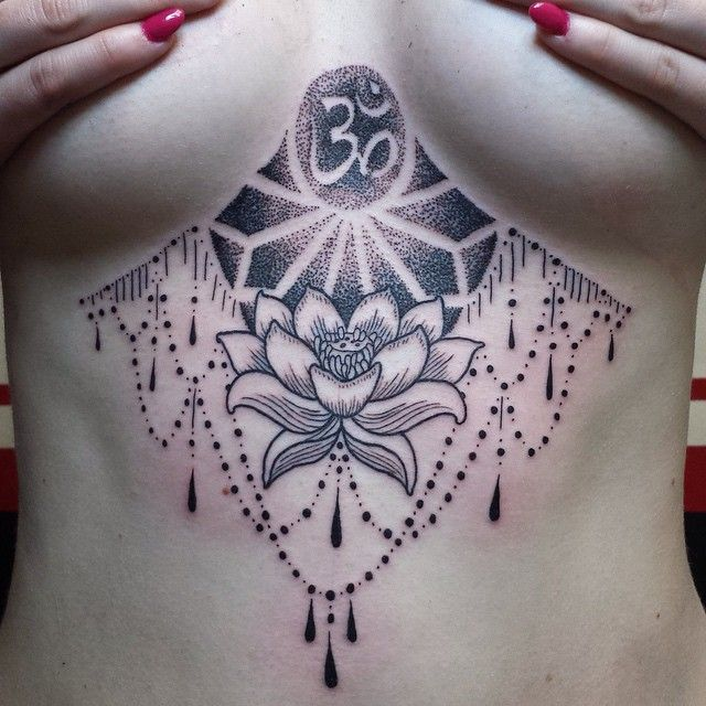 Nice dotwork underboob tattoo by Evan from Tat-a-rama.
