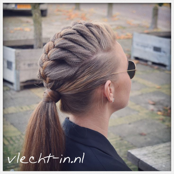 Mohawk Braid: Take your hair to new heights with this teased and braided faux-hawk 'do.