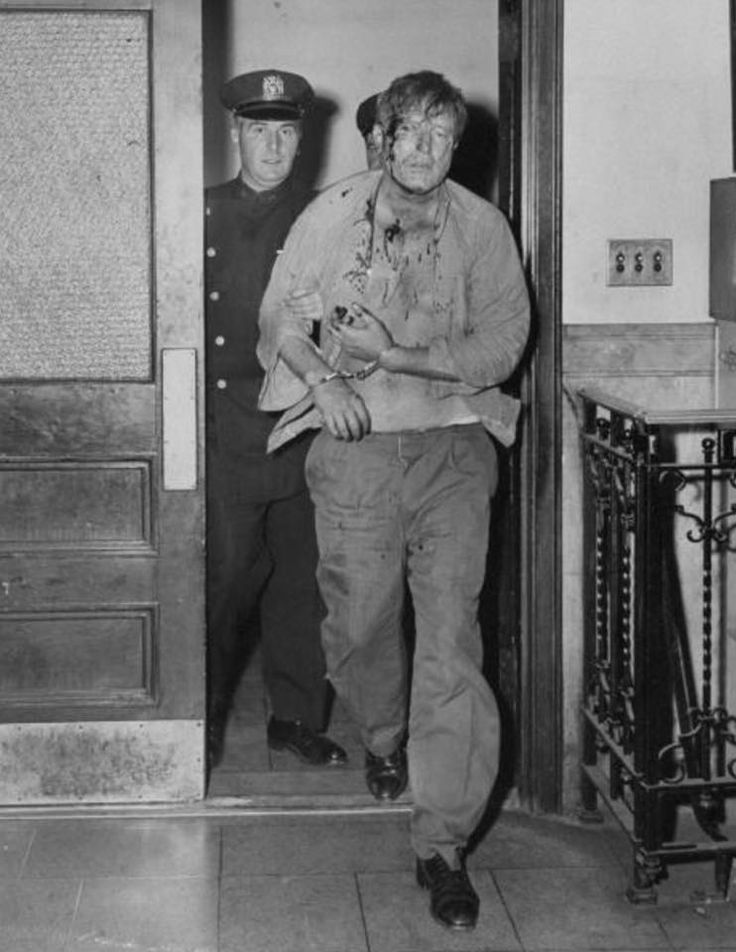 Lawrence Tierney booked at W 54th St police station on charges of felonious assault in 1958.