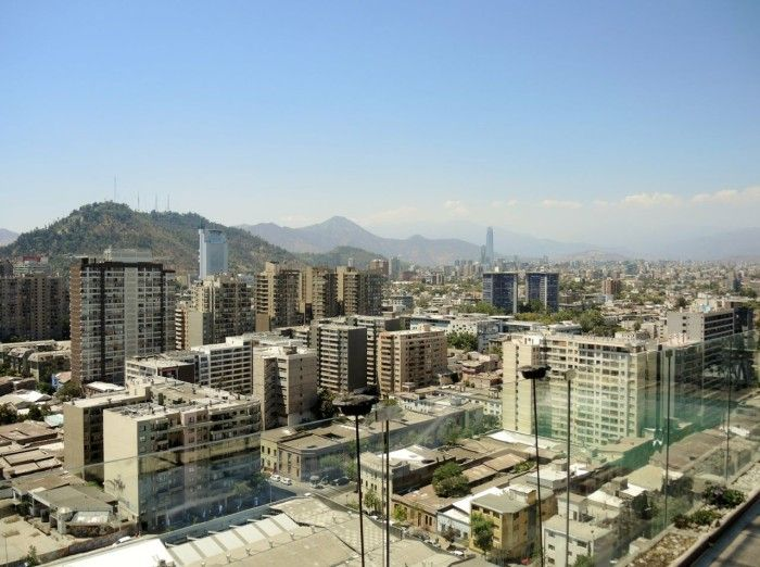 View of city from hotel rooftop with a backdrop of the Andes.
