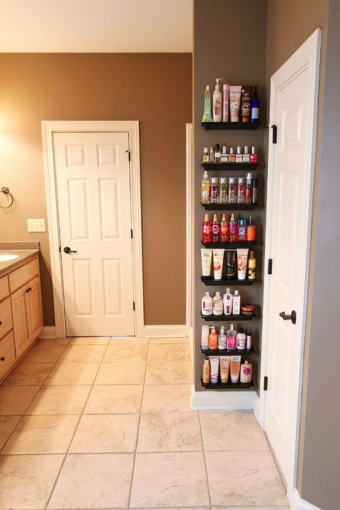I like this – it almost makes it look like a salon or spa! Organize Overflowing Bathroom Beauty Products with Crown Molding Shelves @ DIY Home Ideas. Hmmmm. maybe?