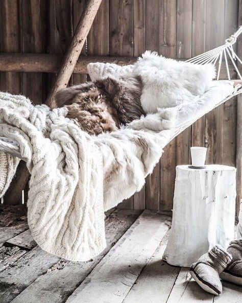 Imagining lazy days snuggled with a book here.... via @myluxurylinen