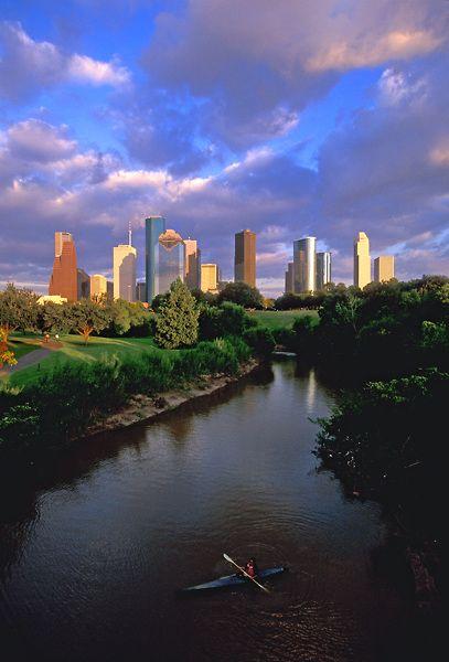 Stock photo of kayaking on Buffalo Bayou on the west side of the Houston,Texas skyline