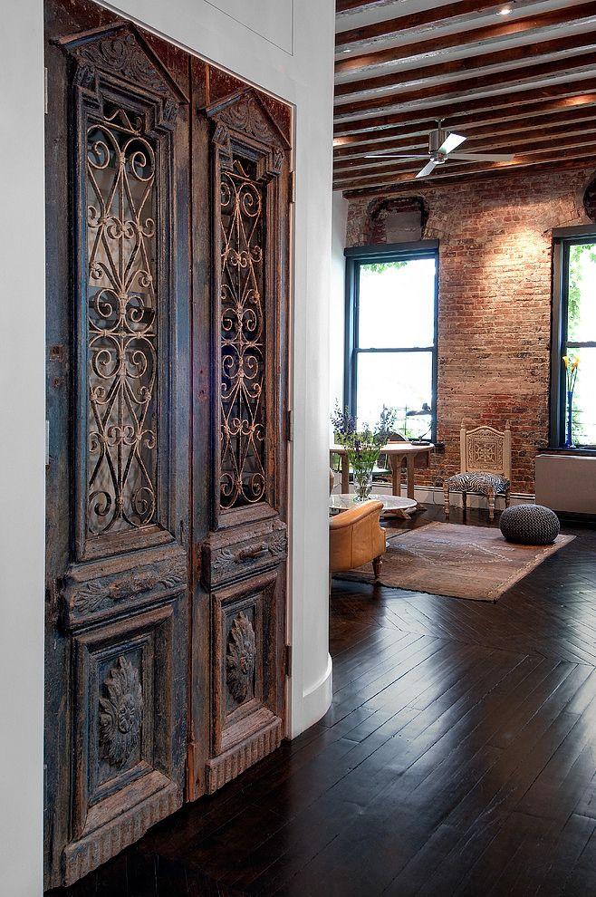 dark floors + antique french doors + exposed brick + beams