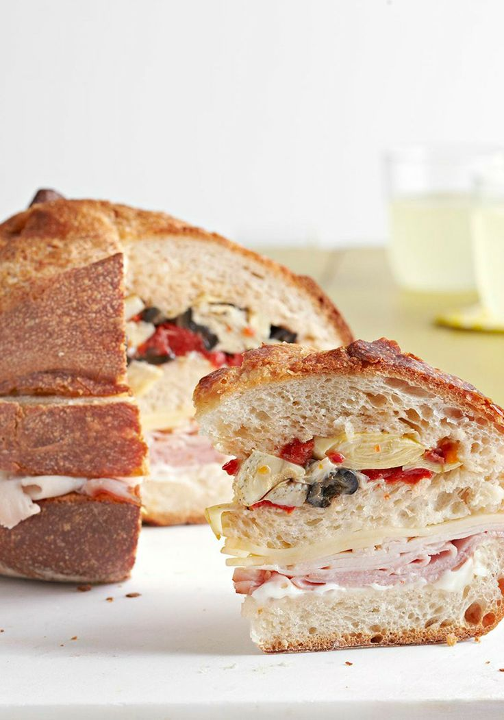 Antipasto Sub Club Sandwich — Popular antipasto ingredients are layered onto a round Italian bread loaf spread with minced garlic and mayo to make these tasty appetizer sandwich wedges. Plus, the recipe is refrigerator-ready in just 15 minutes flat.