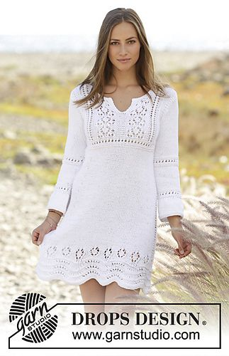 Knitted dress with lace pattern and ¾ sleeves in DROPS Paris. Size: S - XXXL
