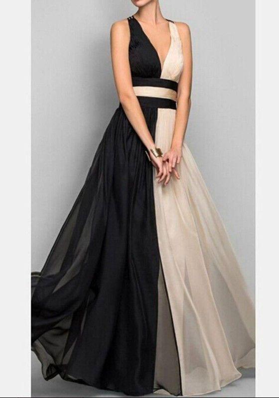 Maxi vestido de color beige cortado escote muy plisada negro