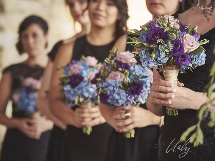 Bridesmaids in black with colourful bouquets #weddingflower #tuscanywedding