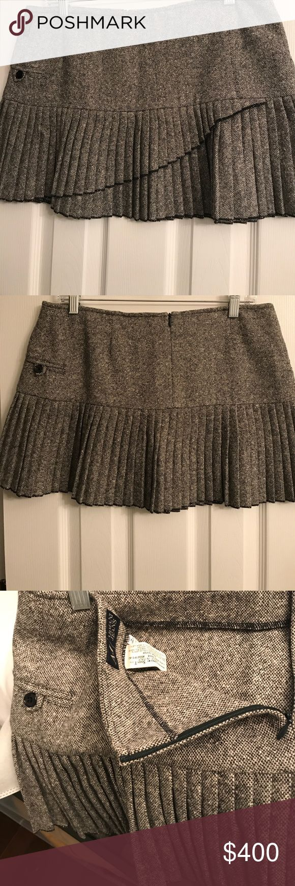 Armani Jean Grey Pleated Skirt Only worn once! Perfect condition! Armani Jeans Grey Pleated skirt. USA Size 10. Zipper in the back. Front has small pocket with Armani J label. Armani Jeans Skirts Midi
